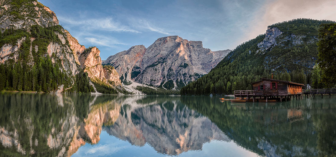 Panoramic shot of the Lake Prags with mountains reflecting in water